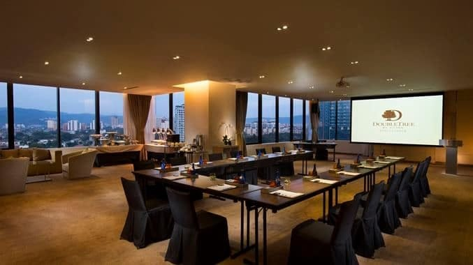 A meeting room that allows for more natural sunlight and a view of the city. Source: DoubleTree by Hilton Hotel Kuala Lumpur